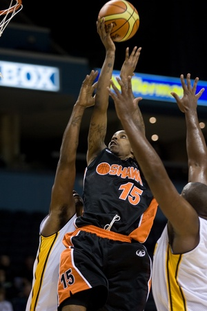 London Ontario, Canada - October 23, 2011. Jahaziel Howard (15) of the Oshawa Power goes up for basket in a game against the London Lightning. London won the game 111-83.   Editorial