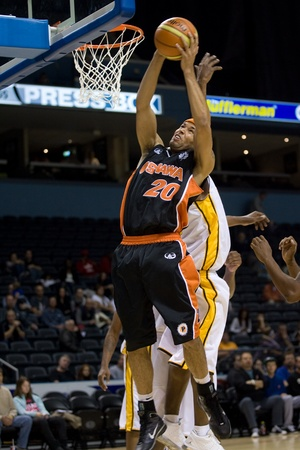 London Ontario, Canada - October 23, 2011. Morgan Lewis (20) of the Oshawa Power picks up a rebound in a game against the London Lightning. London won the game 111-83.