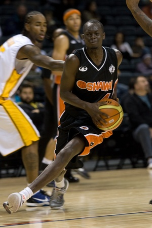 London Ontario, Canada - October 23, 2011. Tut Ruach of the Oshawa Power splits the defence in a preseason game against the London Lightning. London won the game 111-83.  Editorial