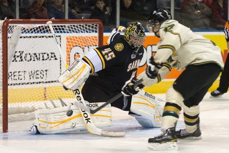 London Ontario, Canada - October 30, 2011. Seth Griffith (17) of the London Knights gets the puck past Brandon Maxwell (45) of the Sarnia Sting during a shootout to decide their game. London won the game 3-2.