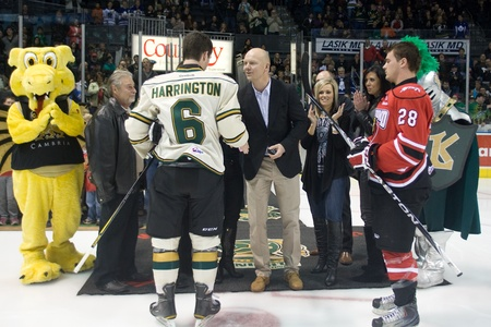 john labatt centre: London Ontario, Canada - October 28, 2011. Former Toronto Maple Leaf captain Mats Sundin speaks with Scott Harrington (6) of the London Knights after dropping the puck prior to the game. London won the game in overtime 3-2.  Editorial