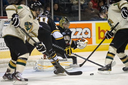 maxwell: London Ontario, Canada - October 30, 2011. Sarnia goalie Brandon Maxwell moves to make a save during their game against the London Knights. London won the game in an overtime shootout 3-2.