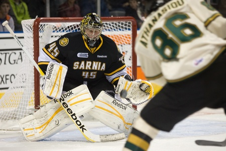 maxwell: London Ontario, Canada - October 30, 2011. Sarnia goalie Brandon Maxwell prepares to stop a shot from Andreas Athanasiou of the London Knights in their game. London won the game 3-2 in an overtime shootout.  Editorial