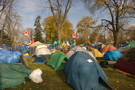 London Ontario, Canada - November 8, 2011. The Occupy London encampment in Victoria Park woke to notices posted around their camp to vacate the park by 6pm.