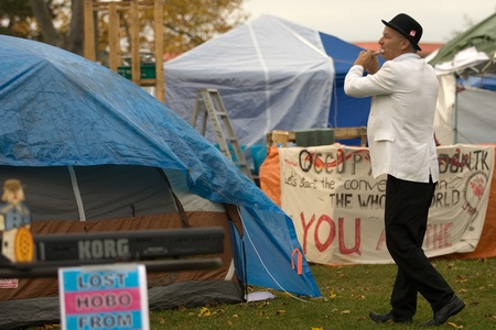 London Ontario, Canada - November 8, 2011. The Occupy London encampment in Victoria Park woke to notices posted around their camp to vacate the park by 6pm.  As 6pm approached protestors moved resources to a singular tent where they later surrounded by li Editorial