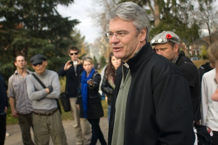 vacate: London Ontario, Canada - November 8, 2011. The Occupy London encampment in Victoria Park woke to notices posted around their camp to vacate the park by 6pm.  At mid-day the movement was dealt another setback as Dean Kevin Dixon told protestors they could