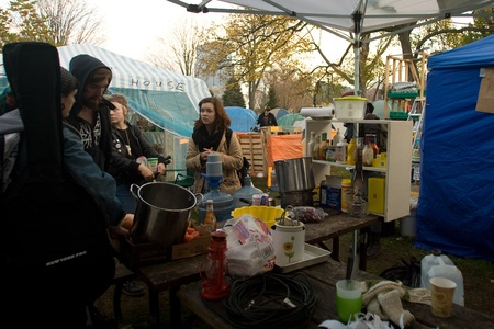 occupy london: London Ontario, Canada - November 8, 2011. The Occupy London encampment in Victoria Park woke to notices posted around their camp to vacate the park by 6pm.  As 6pm approached protestors moved resources to a singular tent where they later surrounded by li Editorial