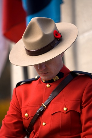 victoria park: London Ontario, Canada - November 11, 2011. A RCMP officer stands a post during Remembrance Day ceremonies at the Cenotaph in Victoria Park in London Ontario Canada.  Editorial
