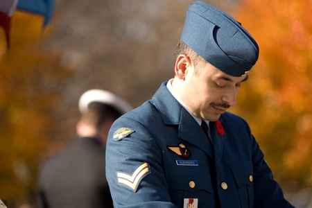 victoria park: London Ontario, Canada - November 11, 2011. A Canadian airman and sailor stand posts during Remembrance Day ceremonies at the Cenotaph in Victoria Park in London Ontario Canada.