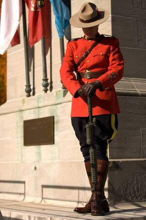 London Ontario, Canada - November 11, 2011. A RCMP officer stands a post during Remembrance Day ceremonies at the Cenotaph in Victoria Park in London Ontario Canada.