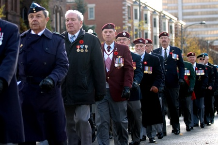 victoria park: London Ontario, Canada - November 11, 2011. Veterans march during Remembrance Day ceremonies at the Cenotaph in Victoria Park in London Ontario Canada.