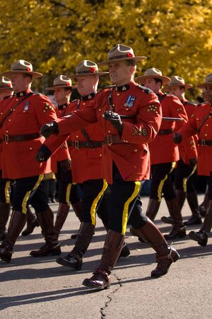 London Ontario, Canada - November 11, 2011. RCMP officers march during Remembrance Day ceremonies at the Cenotaph in Victoria Park in London Ontario Canada.