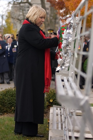 victoria park: London Ontario, Canada - November 11, 2011. Deb Matthews, Minister of Health for Province of Ontario lays a wreath during Remembrance Day ceremonies at the Cenotaph in Victoria Park in London Ontario Canada.