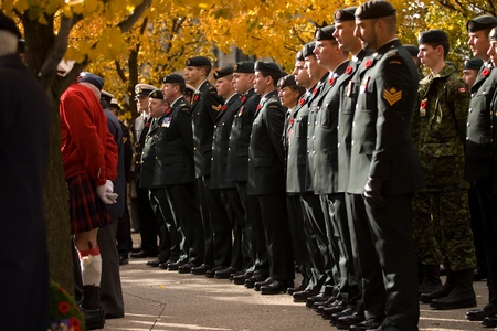 victoria park: London Ontario, Canada - November 11, 2011. Active duty soldiers stand in rank during Remembrance Day ceremonies at the Cenotaph in Victoria Park in London Ontario Canada.