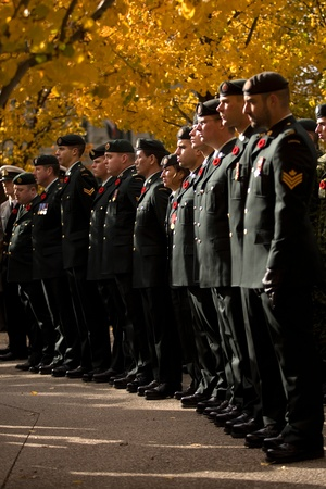 London Ontario, Canada - November 11, 2011. Active duty soldiers stand in rank during Remembrance Day ceremonies at the Cenotaph in Victoria Park in London Ontario Canada.
