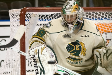 third eye: London Ontario, Canada - November 4, 2011. Michael Houser of the London Knights keeps an eye on the puck as he prepares to make save in a game against the Brampton Battalion. London won the game 3-2 scoring the winning goal in the last minute of the third Editorial
