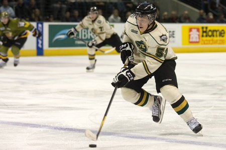 john labatt centre: London Ontario, Canada - November 4, 2011. Bo Horvat of the London Knights carries the puck in a game against the Brampton Battalion.  London won the game 3-2 scoring the winning goal in the last minute of the third period.  Editorial