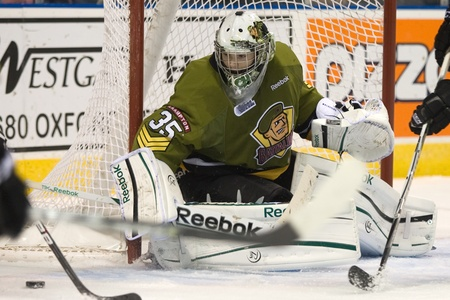 third eye: London Ontario, Canada - November 4, 2011. Brampton Battalion goalie Matej Machovsky keeps a close eye on the puck during a game against the London Knights. London won the game 3-2 scoring the winning goal in the last minute of the third period.  Editorial