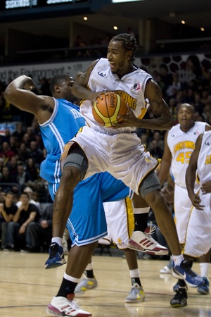 london lightning: London Ontario, Canada - November 4, 2011. Gabe Freeman (25) of the London Lightning collects a rebound in a game against the Halifax Rainmen. London won the game 118-110 in front a crowd of 3600 spectators.