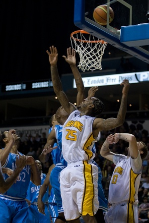 London Ontario, Canada - November 4, 2011. Gabe Freeman goes up for a rebound in a game against the Halifax Rainmen. London won the game 118-110 in front a crowd of 3600 spectators. Editorial
