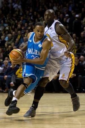 London Ontario, Canada - November 4, 2011. Darrin Dorsey (28) of the Halifax Rainmen drives around a London Lightning player during their game.  London won the game 118-110 in front a crowd of 3600 spectators.