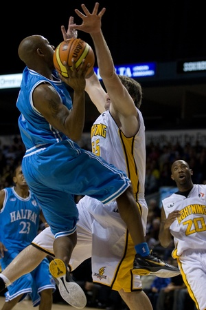 halifax rainmen: London Ontario, Canada - November 4, 2011. Taliek Brown (8) of the Halifax Rainmen goes up for a basket against Michael King (55) of the London Lightning.  London won the game 118-110 in front a crowd of 3600 spectators. Editorial