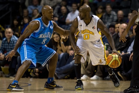 london lightning: London Ontario, Canada - November 4, 2011. DeAnthony Bowden (0) of the London Lightning works against Taliek Brown (8) of the Halifax Rainmen during their game. London won the game 118-110 in front a crowd of 3600 spectators.