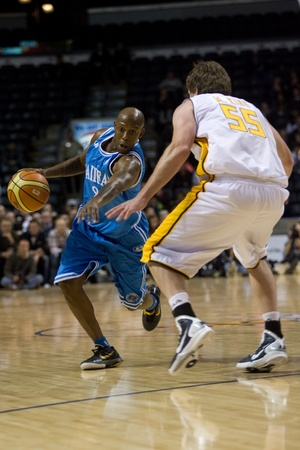 halifax rainmen: London Ontario, Canada - November 4, 2011. Taliek Brown (8) of the Halifax Rainmen drives around Michael King (55) of the London Lighting during their game. London won the game 118-110 in front a crowd of 3600 spectators.