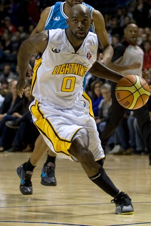 London Ontario, Canada - November 4, 2011. DeAnthony Bowden of the London Lighting carries the ball during a game against the Halifax Rainmen. London won the game 118-110 in front a crowd of 3600 spectators. Editorial