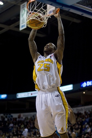 London Ontario, Canada - November 4, 2011. Gabe Freeman dunks the ball during a game against the Halifax Rainmen. London won the game 118-110 in front a crowd of 3600 spectators. Stock Photo - 11355462