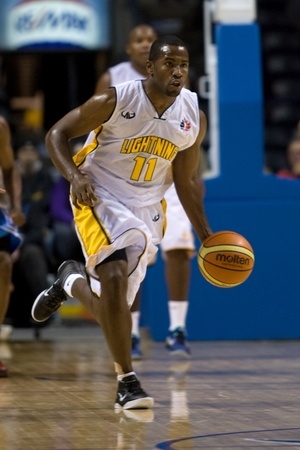 john labatt centre: London Ontario, Canada - November 4, 2011. Brandon Dean of the London Lightning carries the ball up the court in a game against the Halifax Rainmen. London won the game 118-110 in front a crowd of 3600 spectators.