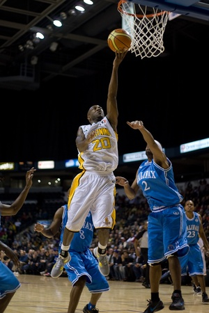 London Ontario, Canada - November 4, 2011. Eddie Smith (20) goes up for a layup during a game between the London Lightning and the Halifax Rainmen. London won the game 118-110 in front a crowd of 3600 spectators. Stock Photo - 11355427