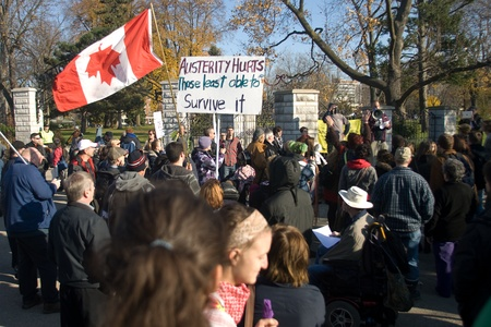 London Ontario, Canada - November 12, 2011. What started out as a rally in Victoria Park, where Occupy London was encamped, turned into an impromptu march through the downtown core. The Police informed the protestors that they were within their rights to  Stock Photo - 11355497