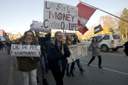 London Ontario, Canada - November 12, 2011. What started out as a rally in Victoria Park, where Occupy London was encamped, turned into an impromptu march through the downtown core. The Police informed the protestors that they were within their rights to  Stock Photo - 11355437