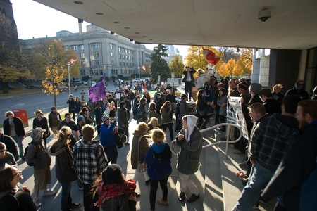 protestor: London Ontario, Canada - November 12, 2011. What started out as a rally in Victoria Park, where Occupy London was encamped, turned into an impromptu march through the downtown core. The Police informed the protestors that they were within their rights to