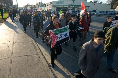 occupy london: London Ontario, Canada - November 12, 2011. What started out as a rally in Victoria Park, where Occupy London was encamped, turned into an impromptu march through the downtown core. The Police informed the protestors that they were within their rights to