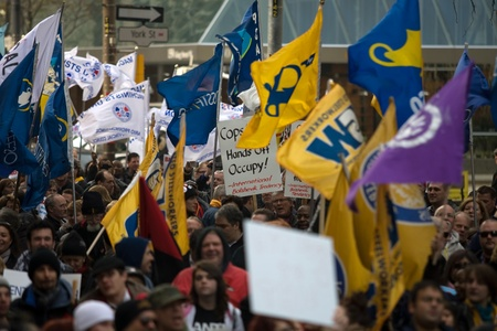 99: Toronto Ontario, Canada - November 24, 2011. Protestors from Occupy Toronto, London, Kingston and Ottawa join Ontario Federation of Labour members led by Sid Ryan march through the financial district of Toronto.  Editorial