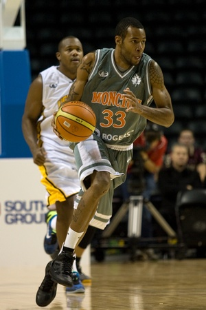 London Ontario, November 24, 2011. Joe Webb (33) carries the ball up court in a National Basketball League of Canada between the London Lightning and Moncton Miracles. London won the game 105-93.  Stock Photo - 11366755