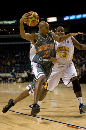 London Ontario, November 24, 2011. Andrew Francis (21) of the Moncton Miracles drives past Shawn Daniels (45) of the London Lightning in a National Basketball League of Canada between the London Lightning and Moncton Miracles. London won the game 105-93.  Editorial