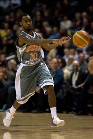 john labatt centre: London Ontario, November 24, 2011. Jazzmar Ferguson (10) of the Moncton Miracles makes a pass in a National Basketball League of Canada between the London Lightning and Moncton Miracles. London won the game 105-93.
