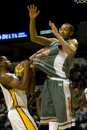 London Ontario, November 24, 2011. Eddie Smith (20) of the London Lightning steals the ball from Terrence Woodyard (22) of the Moncton Miracles in a National Basketball League of Canada between the London Lightning and Moncton Miracles. London won the gam