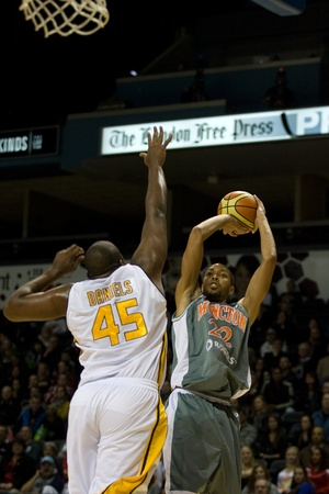 London Ontario, November 24, 2011. Terrence Woodyard (22) of the Moncton Miracles goes up for a shot against Shawn Daniels (45) of the London Lightning in a National Basketball League of Canada between the London Lightning and Moncton Miracles. London won