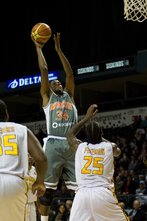 London Ontario, November 24, 2011. Boubacar Coly (34) of the Moncton Miracles goes up for a shot in a National Basketball League of Canada between the London Lightning and Moncton Miracles. London won the game 105-93.  Editorial