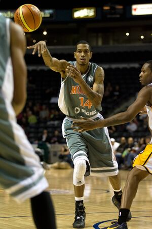 London Ontario, November 24, 2011. Darrell Wonge (14) of the Moncton Miracles makes a pass in a National Basketball League of Canada between the London Lightning and Moncton Miracles. London won the game 105-93.