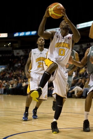 london lightning: London Ontario, November 24, 2011. DeAnthony Bowden (0) of the London Lightning drives to the basket in a National Basketball League of Canada between the London Lightning and Moncton Miracles. London won the game 105-93.  Editorial