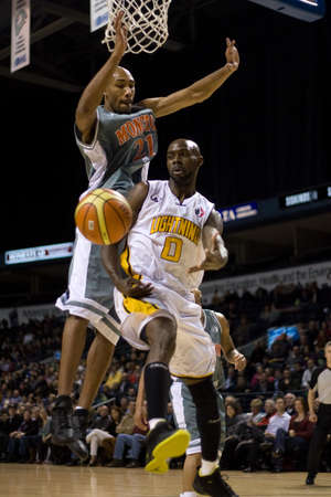 london lightning: London Ontario, November 24, 2011. DeAnthony Bowden (0) of the London Lightning makes a pass while Andrew Francis (21) of Moncton Miracles defends against a basket in a National Basketball League of Canada between the London Lightning and Moncton Miracles
