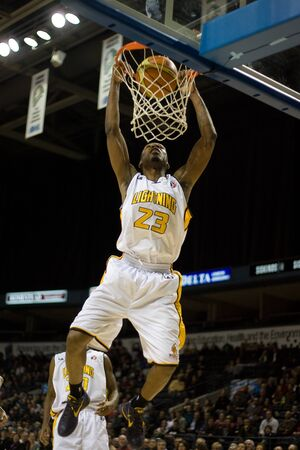 john labatt centre: London Ontario, November 24, 2011. Tim Ellis (23) of the London Lightning dunks a ball in a National Basketball League of Canada between the London Lightning and Moncton Miracles. London won the game 105-93.  Editorial