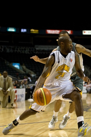 London Ontario, November 24, 2011. Tim Ellis (23) of the London Lightning drives to the net in a National Basketball League of Canada between the London Lightning and Moncton Miracles. London won the game 105-93.  Editorial