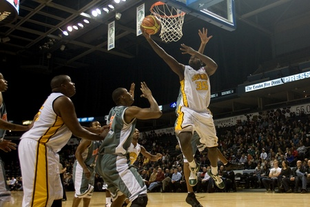 john labatt centre: London Ontario, November 24, 2011. Shamari Spears of the London Lightning goes up for a basket in a National Basketball League of Canada between the London Lightning and Moncton Miracles. London won the game 105-93.