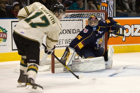 barrie: London Ontario, Canada - November 25, 2011. Barrie Colt goalie Mathias Niederberger (35) is caught without his stick as he tries to make a save against Seth Griffith (17) of the London Knights in a Ontario Hockey League game between the Barrie Colts and t
